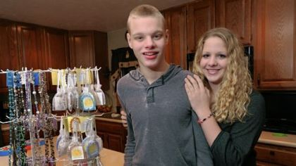 Derek Sleith and his sister, Raeann, in their home in North Huntingdon. Derek, 17, was born with Cri du Chat syndrome; his sister has raised $33,000 for charity by making bracelets.