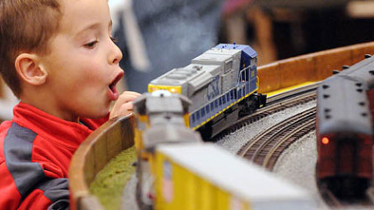Matthew Wakefield, 4, of Monroeville watches the O-gauge train layout presented by the Pittsburgh Independent Hi-Railers club at Greenberg's Train & Toy Show at the Convention Center in Monroeville.