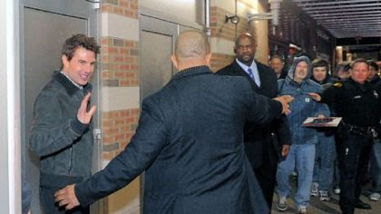 Actor Tom Cruise leaves via a side door of the SouthSide Works Cinema after introducing his new film &quot;Jack Reacher&quot; at a free screening.