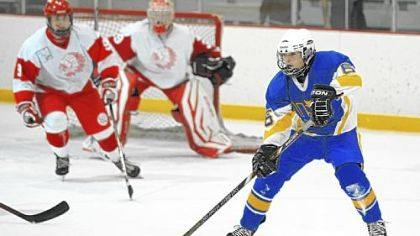 Hampton's Ethan Hornitz handles the puck against North Hills in November,