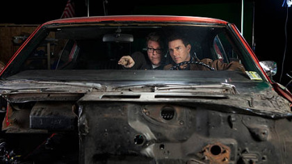 "Director and screenwriter Christopher McQuarrie and Tom Cruise on the set of ""Jack Reacher."""