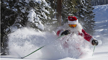 Gregory A. Gull Jr., dressed as Santa Claus, skis on Thursday in fresh snow in Crested Butte, Colo. Light snow began falling this morning in Pittsburgh on the first day of winter.
