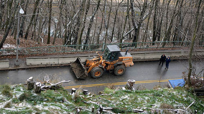 A Pittsburgh Public Works Department crew cleans debris on McArdle Roadway today after a minor landslide.
