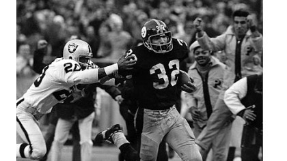 The Steelers&#039; Franco Harris, right, eludes a tackle attempt by the Raiders&#039; Jimmy Warren on the way to scoring on a play known as the &quot;Immaculate Reception.&quot;