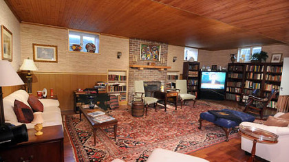 The basement game room has everything needed for family entertainment plus a wood-burning fireplace.