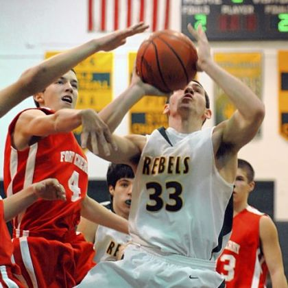 Seton-LaSalle&#039;s Luke Brumbaugh draws the defensive attention of Fort Cherry&#039;s Phil Baker in the first half Friday night at Seton-LaSalle.