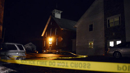 Officials investigate the scene at Juniata Valley Gospel Church Friday where one woman was shot and killed.