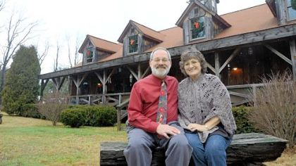 Ron and Marie Songer built their house by disassembling and rebuilding an old barn and repurposing materials from others.
