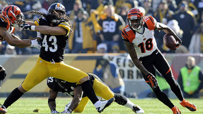 Bengals' A.J. Green carries around Steelers' Troy Polamalu in the first quarter at Heinz Field Sunday.