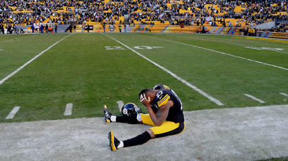 Ryan Clark sits on the sidelines in the final second of the fourth quarter of Sunday's loss to the Bengals.