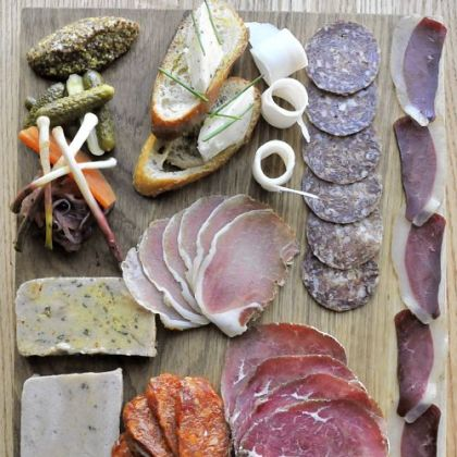 The salumi board includes terrine, duck speck, baseola, salami, chorizo and lardo.