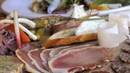 The salumi board at Cure features meat cured in-house with accompaniments.