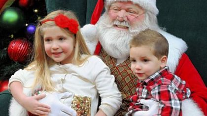Sharlie Mecham, 4, of Munhall and her brother Cole, 2 enjoy their visit with Santa Ron.