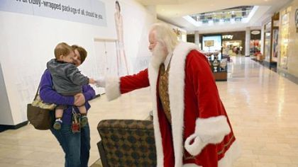 Santa Ron greets Benson, 14 months, and his mother Denise Griffith of Shaler.