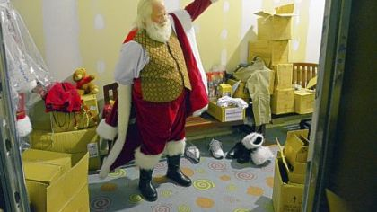 """Santa Ron""  gets dressed at the North Pole before going to work at Ross Park Mall."