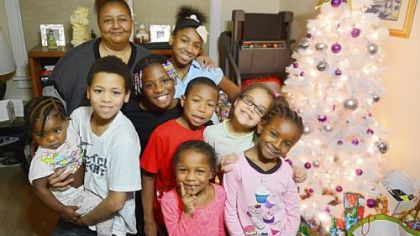 Toni Jones with her grandchildren, from left, Antionette, 2, Judah, 11, Makenzie, 8, Justice, 12, (back), Manuel, 7, Unique, 5, Treyhauna, 8, and Makeeda, 8, inside her Brighton Heights home.