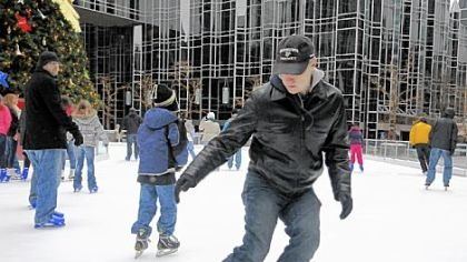 Eric Swanson, a University of Pittsburgh physics professor as well as an amateur hockey player, comes to a stop Saturday while demonstrating the science behind ice skating at the rink in PPG Place, Downtown.