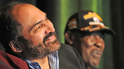 "Franco Harris, left, and John ""Frenchy"" Fuqua listen to a story about the Immaculate Reception during an anniversary celebration Saturday at the Heinz History Center in the Strip District."