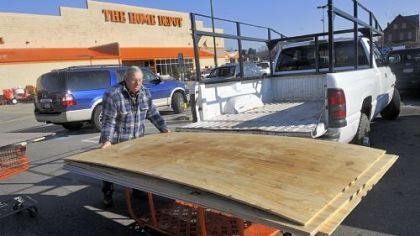 Anton Abraham of Oakland loads his truck with building supplies at Home Depot in East Liberty.
