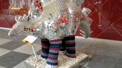 "To promote the arrival of the world-premiere of ""Flashdance the Musical,"" the Pittsburgh Cultural Trust partnered with Natural Stitches of East Liberty for Project: Legwarmer Pittsburgh. The result: leg warmers on the Art Institute T-rex, Downtown."