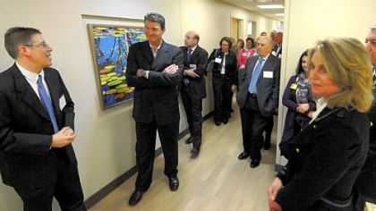 Mario Lemieux listens to tour guide David Wells at the opening of the new Mario Lemieux Center for Blood Cancers at the Hillman Cancer Center. Natalie Lemieux is at right.