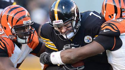 Steelers quarterback Ben Roethlisberger is sacked during Sunday's game by Bengals Geno Atkins and Carlos Dunlap.