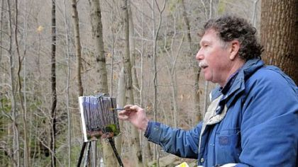"Charles ""Bud"" Gibbons paints in the Roaring Run Watershed near New Kensington, one of his favorite locations. He drew elements of his painting, ""Winter,"" from this site and another in Forbes State Forest."