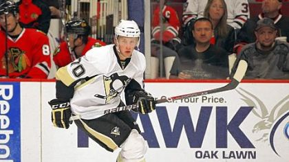 The Penguins' No. 4 prospect Joe Morrow skates up the ice against the Chicago Blackhawks in a 2011 preseason game.