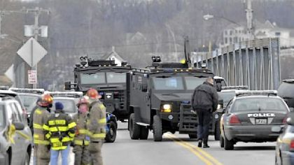SWAT teams appear at the scene of a fire Monday in Webster, N.Y. Police say a man who killed two firefighters in a Christmas Eve ambush had served 17 years for manslaughter in the death of his grandmother.