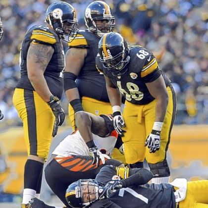 Steelers quarterback Ben Roethlisberger is slow to get up after getting hit by the Bengals in the fourth quarter Sunday at Heinz Field.
