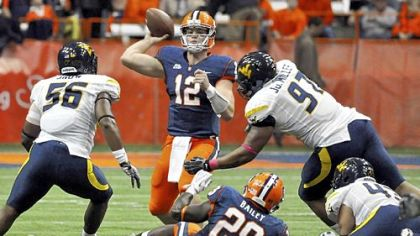Syracuse quarterback Ryan Nassib (12) threw for 229 yards and four touchdowns as the Orange beat West Virginia, 49-23, last season.