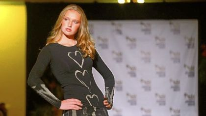 "A model walks down the runway during the kickoff event of Pittsburgh Fashion Week in an eco-chic fashion show called ""Green is the new black"" at Soldiers & Sailors Memorial Hall in Oakland. Fashion Week expanded its reach in 2012, its third year."