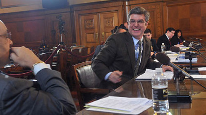 Pittsburgh City Council member Patrick Dowd, right, talks with council member Rev. Ricky Burgess before a vote was taken about  postponing parking meter enforcement  at night until summer 2013.  The measure passed with only Dowd abstaining.