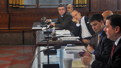 Members of Pittsburgh City Council listen to council member Bill Peduto talk about postponing parking meter enforcement  at night until summer 2013.  The measure passed with only Patrick Dowd abstaining.  (L-R) Dowd, Rev. Ricky Burgess, Bruce Kraus Corey O'Connor, R. Daniel Lavelle, Peduto.