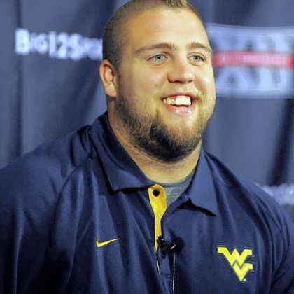 West Virginia center Joe Madsen will miss the Pinstripe Bowl after being declared academically ineligible.