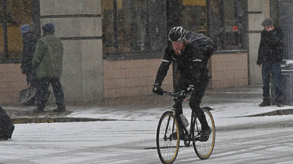A bicyclist rolls down Liberty Avenue in Downtown Pittsburgh this morning.