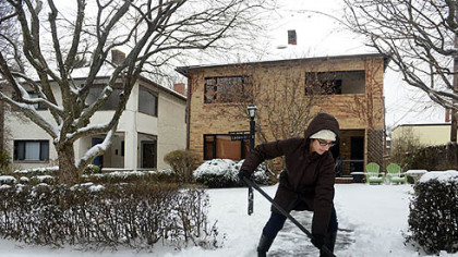 Zaynab Siddiqui of Squirrel Hill shovels off her walkway along Darlington Avenue in Squirrel Hill.