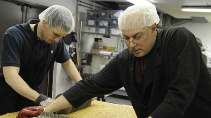 April: Operations manager Conor Foley helps production manager Greg Muckle with a batch of almond butter toffee at the Edward Marc Chocolatier shop in Trafford.