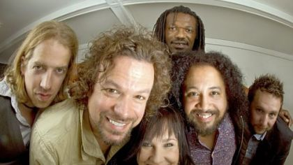 "Rusted Root -- from left: Colter Harper, Michael Glabicki, Liz Berlin, Peach Freedom (back), Patrick Norman and Dirk Miller -- will celebrate its latest, ""The Movement,"" at Mr. Smalls tonight."
