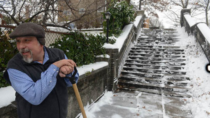 Don Martello of Squirrel Hill works to clear a staircase leading to his housing complex on the heels of a heavy snowstorm on Wednesday.