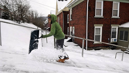 Dreshawn Craighead, 13, shovels while going up First Street in Wilmerding on Wednesday. He was looking for snow shoveling jobs in his neighborhood after yesterday&#039;s storm.