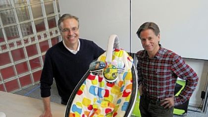Richard Lunak, left, president and CEO of Innovation Works, and Henry Thorne, chief technical officer at 4Moms, show their mamaRoo vibrating seat for children.  Innovation Works is a program of the Ben Franklin Technology Partners program.