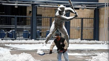 Pittsburgh Pirates staffer Hank Robinson clears snow Thursday outside of PNC Park.