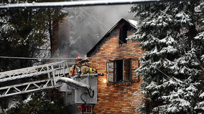 Firefighters battle a fire that killed two people Thursday at 916 McNeilly Road in Mt. Lebanon.