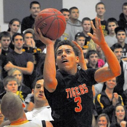 Elijah Cottrill of Beaver Falls drives toward the basket against Montour Thursday at Montour.