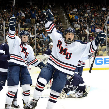 Robert Morris&#039; Cody Wydo celebrates after scoring in the first period Friday against Penn State in the Three Rivers Classic at Consol Energy Center.
