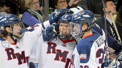 Robert Morris&#039; Tyler Hinds, middle, is congratulated after scoring in the third period against Penn State in the Three Rivers Classic Friday at Consol Energy Center.
