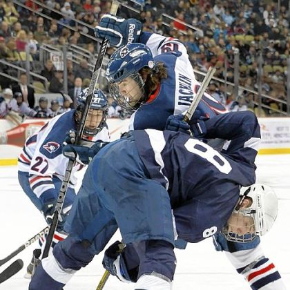 Robert Morris&#039; Scott Jacklin battles for a loose puck with Penn State&#039;s Michael McDonagh in the first period Friday at Consol Energy Center.