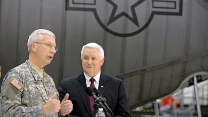 Adjutant General of Pennsylvania Wesley Craig, left, talks to the media at the 911th Airlift Wing in Moon on Friday as Gov. Tom Corbett looks on.