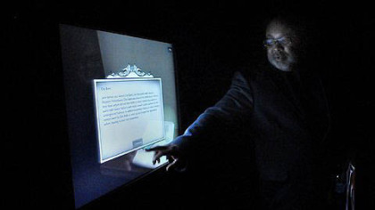 Samuel Black demonstates the interactive computer program used in the new exhibition, &quot;From Slavery to Freedom.&quot;